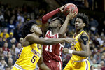 Oklahoma's De'Vion Harmon (11) goes to the basket between Minnesota's Marcus Carr (5) and Daniel Oturu (25) during the first half of an NCAA college basketball game in Sioux Falls, S.D., Saturday, Nov. 9, 2019. (AP Photo/Nati Harnik)