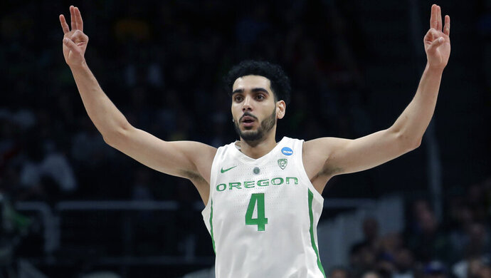 FILE - In this March 24, 2019, file photo, Oregon guard Ehab Amin gestures during a second-round game against UC Irvine  in the NCAA men's college basketball tournament, in San Jose, Calif. (AP Photo/Jeff Chiu, File)