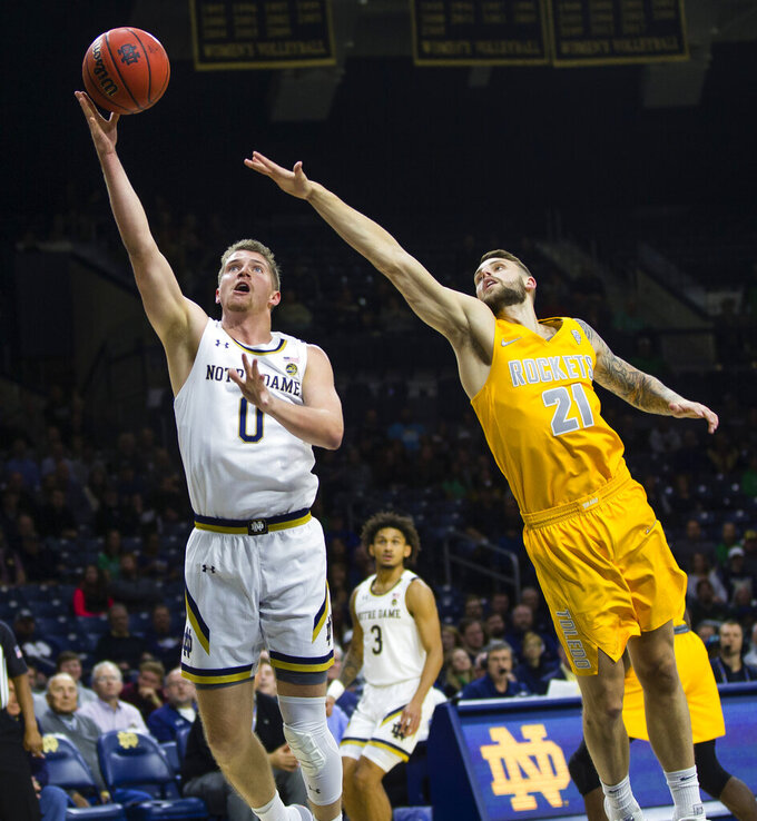 Notre Dame's Rex Pflueger (0) drives past Toledo's Dylan Alderson (21) during an NCAA college basketball game Thursday, Nov. 21, 2019, in South Bend, Ind. (Michael Caterina/South Bend Tribune via AP)