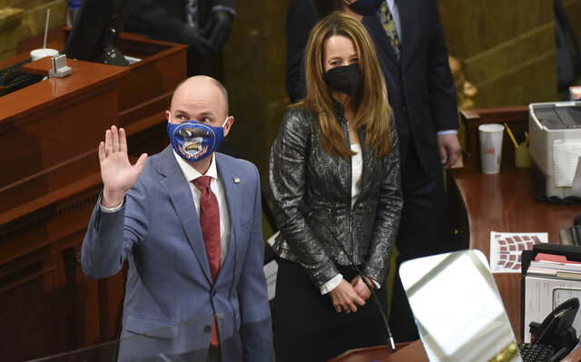 Gov. Spencer Cox, alongside his wife Abby Cox, are greeted as they enter the House chamber for the State of the State address at the Utah State Capitol in Salt Lake City on Thursday, Jan. 21, 2021. (Francisco Kjolseth/The Salt Lake Tribune via AP, Pool)