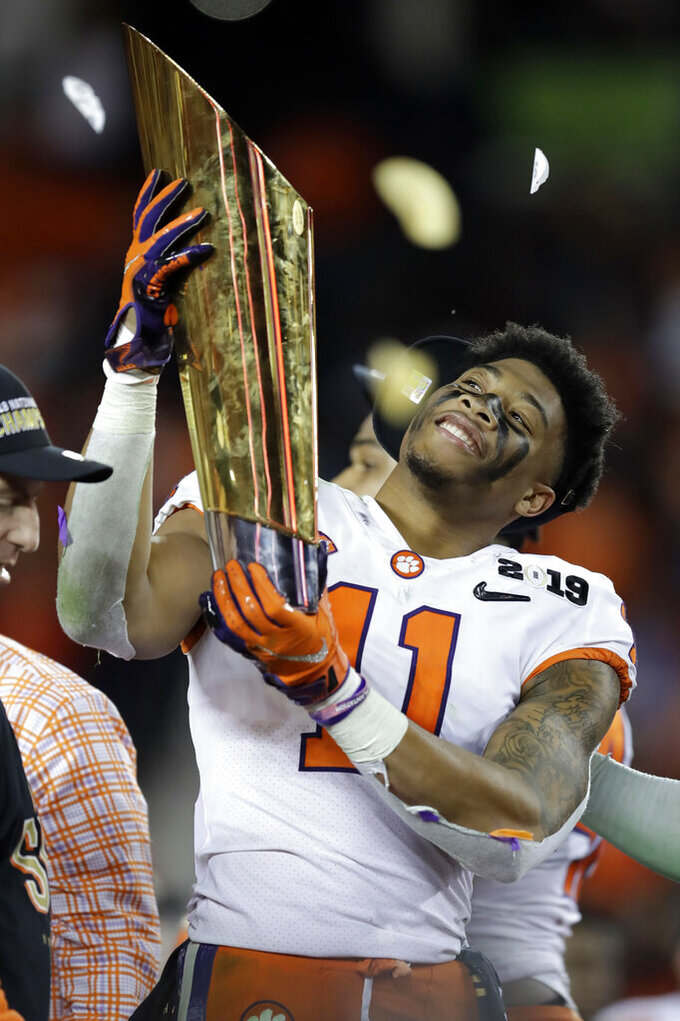 Clemson's Isaiah Simmons celebrates after the NCAA college football playoff championship game against Alabama, Monday, Jan. 7, 2019, in Santa Clara, Calif. Clemson beat Alabama 44-16. (AP Photo/Ben Margot)