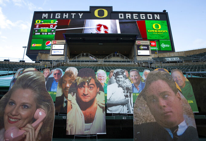 "Cutouts of cast members from the movie ""Animal House"" take the place of Oregon Duck fans at Autzen Stadium as Stanford and Oregon get ready for their first NCAA college football game of the season Saturday, Nov. 7, 2020, in Eugene, Ore. (AP Photo/Chris Pietsch)"