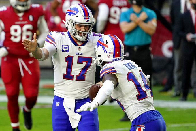 Buffalo Bills quarterback Josh Allen (17) celebrates his touchdown with wide receiver Stefon Diggs (14) during the first half of an NFL football game against the Arizona Cardinals, Sunday, Nov. 15, 2020, in Glendale, Ariz. (AP Photo/Rick Scuteri)