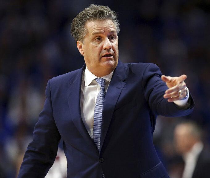 Kentucky head coach John Calipari calls back to his bench during the second half of an NCAA college basketball game against Texas A&M in Lexington, Ky., Tuesday, Jan. 8, 2019. Kentucky won 85-74. (AP Photo/James Crisp)
