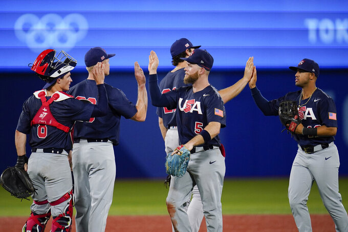 Team United States celebrate their win against Israel after a baseball game at the 2020 Summer Olympics, Friday, July 30, 2021, in Yokohama, Japan. The United States won 8-1. (AP Photo/Sue Ogrocki)