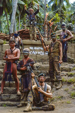 This image provided by Zoetrope Corp. shows Kurtz's army on the steps of his jungle compound in a scene from