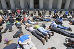 Protesters gather at the Ohio Statehouse for a peaceful protest Sunday, May 31, 2020, over the death of George Floyd in Minnesota, a black man who was killed in police custody in Minneapolis on May 25.   (Doral Chenoweth/The Columbus Dispatch via AP)