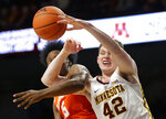 Minnesota forward Michael Hurt (42) and Clemson forward John Newman III (15) battle for a rebound in the second half during an NCAA college basketball game Monday, Dec. 2, 2019, in Minneapolis. (AP Photo/Andy Clayton-King)