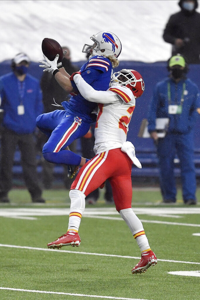 Kansas City Chiefs' Rashad Fenton, right, breaks up a pass intended for Buffalo Bills' Cole Beasley during the first half of an NFL football game, Monday, Oct. 19, 2020, in Orchard Park, N.Y. (AP Photo/Adrian Kraus)