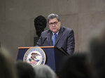U.S. Attorney General William Barr delivers remarks to announce the establishment of the President's Commission on Law Enforcement and the Administration of Justice, at an event at the Department of Justice Headquarters, Wednesday, Jan. 22, 2020 in Washington. (AP Photo/Michael A. McCoy)