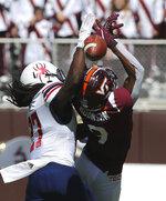 Virginia Tech wide receiver Tayvion Robinson (9) has a pass reception broken up by Richmond's Nile Harris (27) in the first half of the Richmond Virginia Tech NCAA college football game  in Blacksburg, Va., Saturday, Sept. 25 2021. (Matt Gentry/The Roanoke Times via AP)