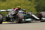 Mercedes driver Valtteri Bottas of Finland steers his car during the first practice session prior to the Formula One Grand Prix at the Spa-Francorchamps racetrack in Spa, Belgium, Friday, Aug. 27, 2021. The Belgian Formula One Grand Prix will take place on Sunday. (AP Photo/Francisco Seco)