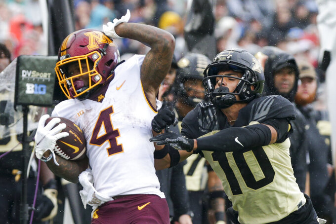 Purdue safety Cam Allen (10) pushes Minnesota running back Mar'Keise Irving (4) out during the second quarter of an NCAA college football game, Saturday, Oct. 2, 2021, at Ross-Ade Stadium in West Lafayette, Ind. (Nikos Frazier/Journal & Courier via AP)