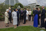 Britain's Queen Elizabeth II, left, speaks to Japanese Prime Minister Yoshihide Suga, at a reception for the G7 leaders at the Eden Project in Cornwall, England, Friday June 11, 2021, during the G7 summit. (Jack Hill/Pool via AP)