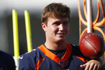 Denver Broncos quarterback Drew Lock takes part in drills during the opening day of the team's NFL football training camp Thursday, July 18, 2019, in Englewood, Colo. (AP Photo/David Zalubowski)