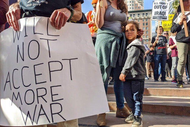 Activists gather in Pershing Square in downtown Los Angeles on Saturday, Jan. 4, 2020, to protest recent U.S. military actions in Iraq. A top Iranian general and Iraqi militiamen were killed in a U.S. airstrike that sharply escalated tensions across the region. (AP Photo/Damian Dovarganes)