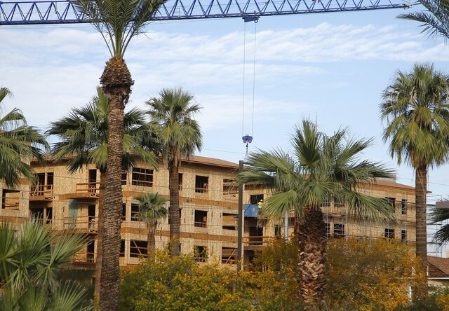 In this Wednesday, Dec. 4, 2019, photo is one of the many new apartment complexes being build in the downtown area in Phoenix. Phoenix has some of the nation's fastest-rising rents as people abandon the cold winters in the Midwest or flee high housing costs in California. (AP Photo/Ross D. Franklin)