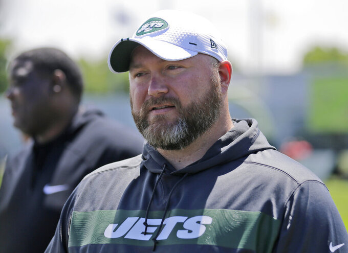 FILE - In this Tuesday, June 11, 2019 file photo, New York Jets general manager Joe Douglas greets reporters during a practice at the team's NFL football training facility in Florham Park, N.J. Joe Douglas understands the frustrations of generations of New York Jets fans. Douglas wants more from the team — more winning, more meaningful games late in the season, more communication. He knows the task at hand for him is building a squad that ends a nine-year postseason drought and, ultimately, deliver the franchise's first Super Bowl appearance since the days of Broadway Joe. (AP Photo/Seth Wenig, File)