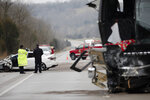 Emergency crews work the scene of a fatal crash involving a charter bus and car on the AA highway in Campbell County, Ky., Saturday,  Jan. 25, 2020. Campbell County police say a charter bus filled with Covington Catholic students was coming from the March for Life in Washington, D.C., when the bus driver hit a vehicle. The driver of the vehicle died.  (Albert Cesare/The Cincinnati Enquirer via AP)