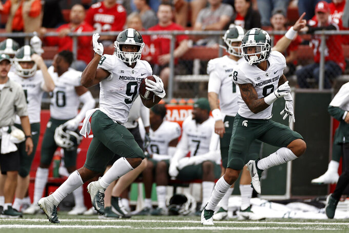 Michigan State running back Kenneth Walker III (9) runs on his way to scoring a 94-yard touchdown against Rutgers during the second half of an NCAA college football game Saturday, Oct. 9, 2021, in Piscataway, N.J. Michigan State won 31-13. (AP Photo/Adam Hunger)