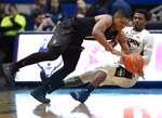 Connecticut's Alterique Gilbert, right, fouls Central Florida's BJ Taylor during the second half of an NCAA college basketball game, Saturday, Jan. 5, 2019, in Hartford, Conn. (AP Photo/Jessica Hill)