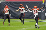 Cincinnati Bengals defensive end Sam Hubbard (94) celebrates with Akeem Davis-Gaither (59) and Carl Lawson (58) after forcing a fumble by Houston Texans quarterback Deshaun Watson during the second half of an NFL football game Sunday, The Bengals recovered the fumble and beat the Texans 37-31. (AP Photo/Sam Craft)