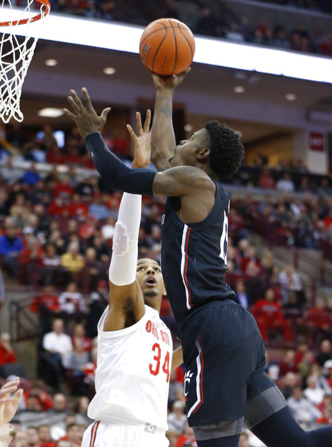 Cincinnati's Tre Scott, right, shoots over Ohio State's Kaleb Wesson during the first half of an NCAA college basketball game Wednesday, Nov. 6, 2019, in Columbus, Ohio. (AP Photo/Jay LaPrete)
