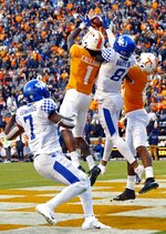 Tennessee wide receiver Marquez Callaway (1) catches a Hail Mary pass for a touchdown while being defended by Kentucky cornerback Derrick Baity Jr. (8) as time expires in the first half of an NCAA college football game Saturday, Nov. 10, 2018, in Knoxville, Tenn. (AP Photo/Wade Payne)