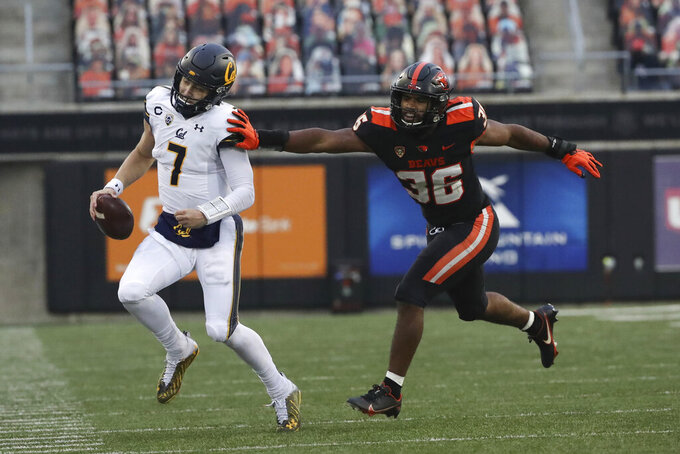 Oregon State inside linebacker Omar Speights (36) pushes California quarterback Chase Garbers (7) out of bounds during the second half of an NCAA college football game in Corvallis, Ore., Saturday, Nov. 21, 2020. Oregon State won 31-27. (AP Photo/Amanda Loman)