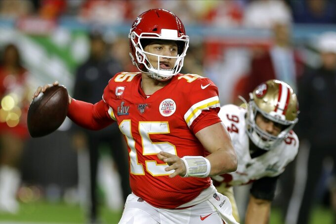 Kansas City Chiefs quarterback Patrick Mahomes drops back to pass against the San Francisco 49ers during the first half of the NFL Super Bowl 54 football game Sunday, Feb. 2, 2020, in Miami Gardens, Fla. (AP Photo/Chris O'Meara)