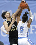 Wake Forest's Ismael Massoud (25) fouls North Carolina's Armando Bacot (5) during the second half of an NCAA college basketball game Wednesday, Jan. 20, 2021, in Chapel Hill, N.C. (Robert Willett/The News & Observer via AP)
