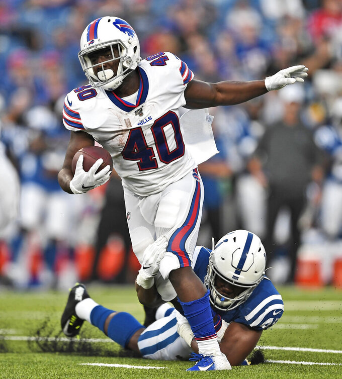 Indianapolis Colts' E.J. Speed, right, brings down Buffalo Bills' Devin Singletary during the first half of an NFL preseason football game, Thursday, Aug. 8, 2019, in Orchard Park, N.Y. (AP Photo/Adrian Kraus)