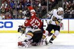 Florida Panthers right wing Evgenii Dadonov (63) collides with Vegas Golden Knights goaltender Marc-Andre Fleury, bottom, during the second period of an NHL hockey game, Thursday, Feb. 6, 2020, in Sunrise, Fla. (AP Photo/Lynne Sladky)