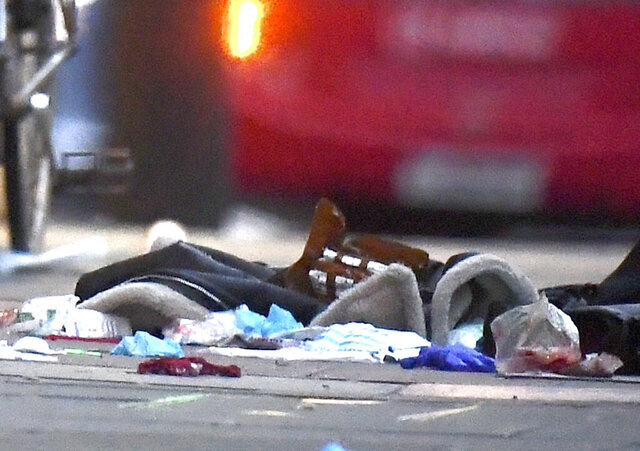 """Items left on the pavement near the scene of a stabbing incident in Streatham High Road, London, Sunday Feb. 2, 2020. London police say officers shot and killed a suspect in a terrorism-related stabbing incident that injured two people. The Metropolitan Police Service said the incident in south London's Streatham neighborhood on Sunday afternoon was """"fully contained."""" (Victoria Jones/PA via AP)"""