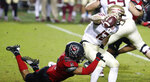 North Carolina State linebacker C.J. Hart Jr. (5) sacks Florida State quarterback Chubba Purdy (12) during the second half of an NCAA college football game Saturday, Nov. 14, 2020, in Raleigh, N.C. (Ethan Hyman/The News & Observer via AP, Pool)