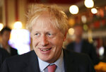 Conservative Party leadership candidate Boris Johnson smiles during a visit to Wetherspoons Metropolitan Bar in London, Wednesday July 10, 2019. (Henry Nicholls/Pool Photo via AP)