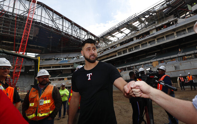 Texas Rangers Joey Gallo is greeted after a batting practice at the under construction baseball field at the new Rangers stadium in Arlington, Texas, Wednesday, Dec. 4, 2019. (AP Photo/LM Otero)
