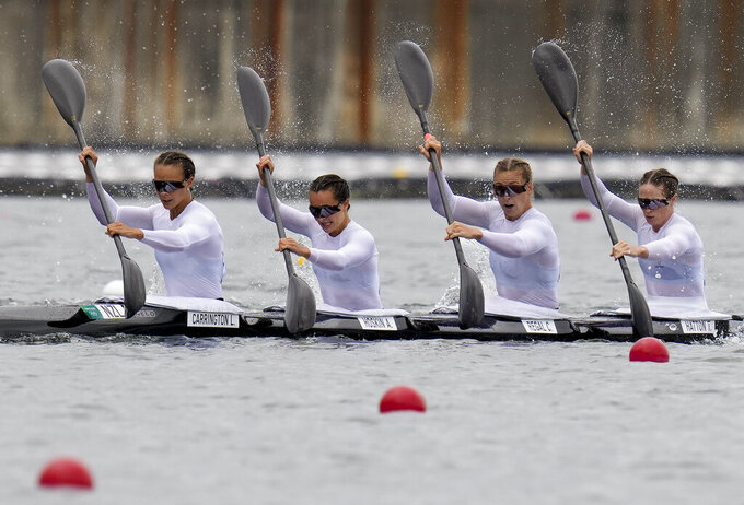 Lisa Carrington, Teneale Hatton, Alicia Hoskin and Caitlin Regal of New Zealand compete in the women's kayak four 500m semifinal at the 2020 Summer Olympics, Saturday, Aug. 7, 2021, in Tokyo, Japan. (AP Photo/Kirsty Wigglesworth)