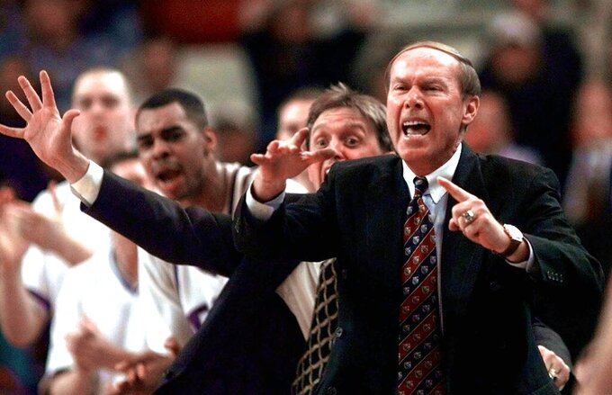 File-This March 13, 1998, file photo shows, TCU head coach Billy Tubbs, front, and assistant coach Steve McClain shouting instructions to their players during their opening-round game in the NCAA Midwest Regional in Oklahoma City.  Former Oklahoma basketball coach Billy Tubbs, whose high-octane system known as Billy Ball brought the Sooners back to prominence in the 1980s, has died at age 85.  (AP Photo/John Gaps III, FILE)
