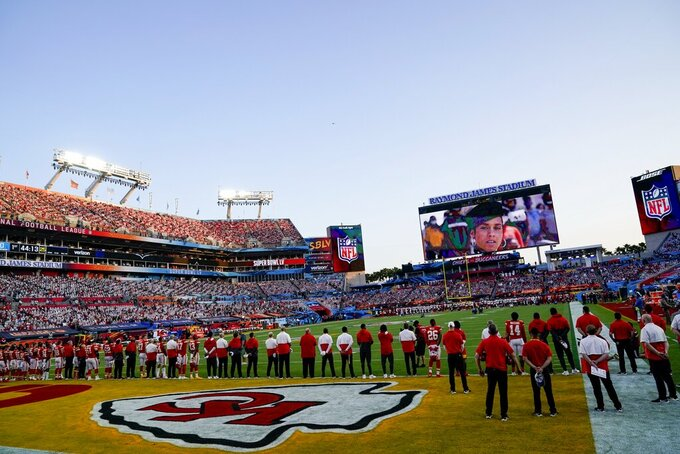 Teams line up before the NFL Super Bowl 55 football game between the Kansas City Chiefs and Tampa Bay Buccaneers, Sunday, Feb. 7, 2021, in Tampa, Fla. (AP Photo/David J. Phillip)