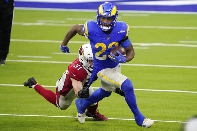 Los Angeles Rams running back Cam Akers (23) runs in front of Arizona Cardinals linebacker Tanner Vallejo (51) during the second half of an NFL football game in Inglewood, Calif., Sunday, Jan. 3, 2021. (AP Photo/Jae C. Hong)