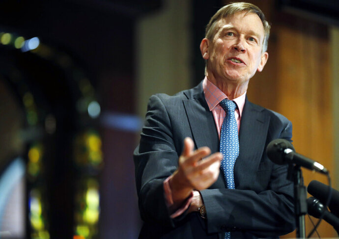 FILE - In this March 6, 2019, file photo, former Colorado Gov. John Hickenlooper speaks in lower downtown Denver. Generations of presidential candidates have made promises to work across the aisle. But as the 2020 campaign kicks into high gear, some Democrats say they have little interest in talk of cross-party cooperation.  (AP Photo/David Zalubowski)