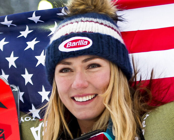 Mikaela Shiffrin of the United States, gold medal, celebrates during the flower ceremony after the women Super-G race at the 2019 FIS Alpine Skiing World Championships in Are, Sweden Tuesday, Feb. 5, 2019. (Jean-Christophe Bott/Keystone via AP)