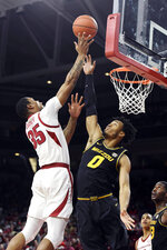 Arkansas' Reggie Chaney (35) shoots over Missouri's Torrence Watson (0) during the first half of an NCAA college basketball game, Wednesday, Jan. 23, 2019, in Fayetteville, Ark. (AP Photo/Michael Woods)