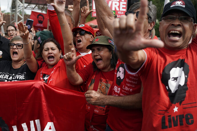 Supporters of Brazil's former President Luiz Inacio Lula da Silva shout