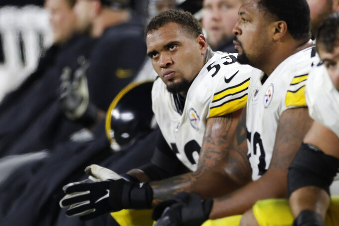 FILE - Pittsburgh Steelers center Maurkice Pouncey (53) sits on the bench during the second half of an NFL football game against the Cleveland Browns, Thursday, Nov. 14, 2019, in Cleveland. Pouncey still isn't thrilled with the collective bargaining agreement the NFL passed just as the pandemic lockdown began. Pouncey says the NFL has never been hurting for money and believes the Players Association should have held out for everything it wanted. (AP Photo/Ron Schwane, File)