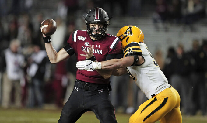 South Carolina quarterback Ryan Hilinski is sacked by Appalachian State linebacker Jordan Fehr (59) in the second half of an NCAA college football game in Columbia, S.C., Saturday, Nov. 9, 2019. (Dwayne McLemore/The State via AP)