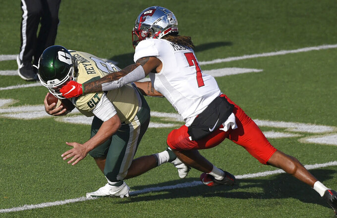 Charlotte quarterback Chris Reynolds, left, is sacked by Western Kentucky defensive back Trae Meadows, right, during the second half of an NCAA college football game on Sunday, Dec. 6, 2020. (Jeff Siner/The Charlotte Observer via AP)