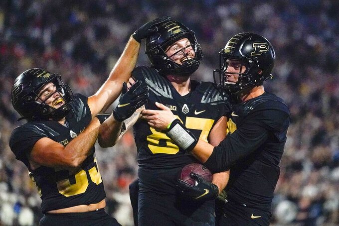 Purdue tight end Payne Durham (87) celebrates a touchdown with wide receiver Jackson Anthrop, left, and quarterback Jack Plummer , right, during the second half of an NCAA college football game Oregon State in West Lafayette, Ind., Saturday, Sept. 4, 2021. (AP Photo/Michael Conroy)