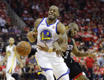 Golden State Warriors forward Andre Iguodala (9) is fouled by Houston Rockets guard Chris Paul (3) during the second half of Game 1 of the NBA basketball Western Conference Finals, Monday, May 14, 2018, in Houston. (AP Photo/David J. Phillip)
